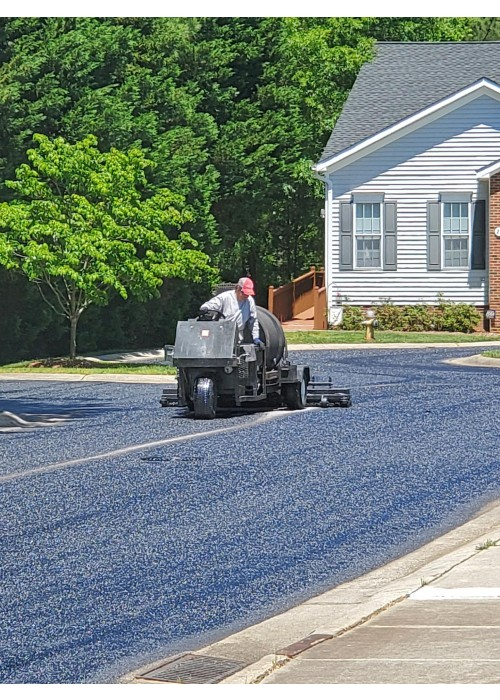 Asphalt Rejuvenation at Homeowners Association in Garner NC.